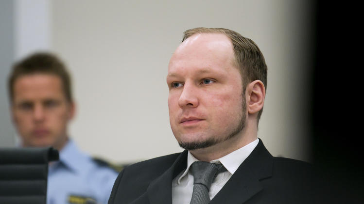 Anders Behnring Breivik, center, sits in the Oslo Courthouse, Oslo, Norway Thursday, May 3, 2012 on the 11th day of the terror trial. Witnesses have described in chilling detail how mass murderer Anders Behring Breivik tricked them into believing he was a policeman on a ferry to Utoya island where he killed 69 people in a shooting spree on July 22.   (P Photo/Heiko Junge/NTB Scanpix, Pool)