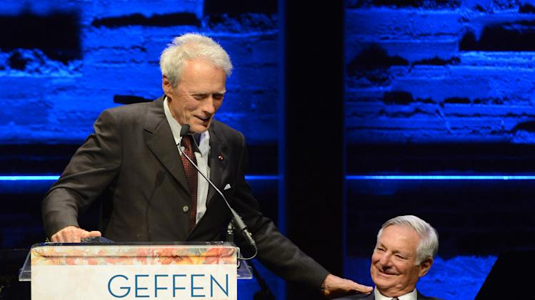 EXCLUSIVE CONTENT - Clint Eastwood, left, presents the distinction in service award to Geffen Playhouse founding chairman of the board Bruce Ramer during the Backstage at the Geffen gala at the Geffen Playhouse on Monday, May 13, 2013, in Los Angeles. (Photo by Jordan Strauss/Invision for Geffen/AP Images)