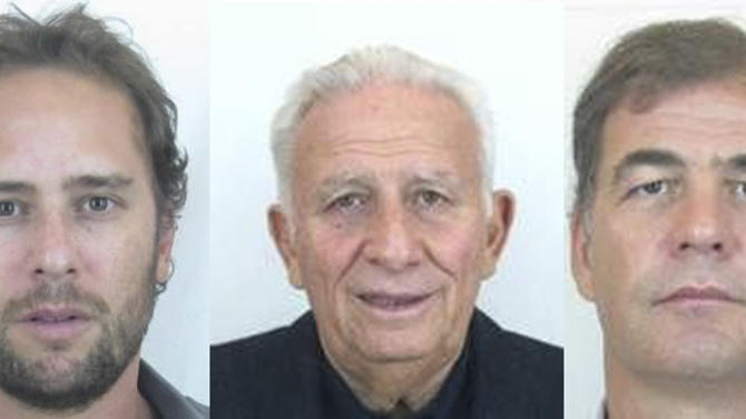 This combo of three pictures released by Interpol shows undated portraits, from left, of Mariano Jinkis, Hugo Jinkis and Alejandro Burzaco. The men, with ties to FIFA, were added to Interpol's most wanted list on Wednesday, June 3, 2015, accused of paying more than $100 million in bribes for media and commercial rights to soccer tournaments. (Interpol via AP)