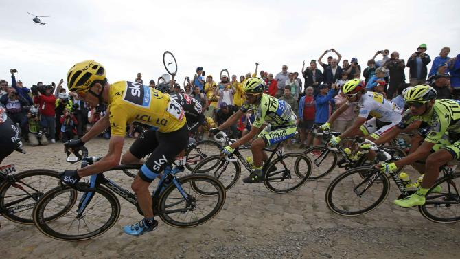 Team Sky rider Chris Froome of Britain, race leader and yellow jersey holder, cycles on a cobble-stoned section during the 4th stage of the 102nd Tour de France cycling race from Seraing in Belgium to Cambrai