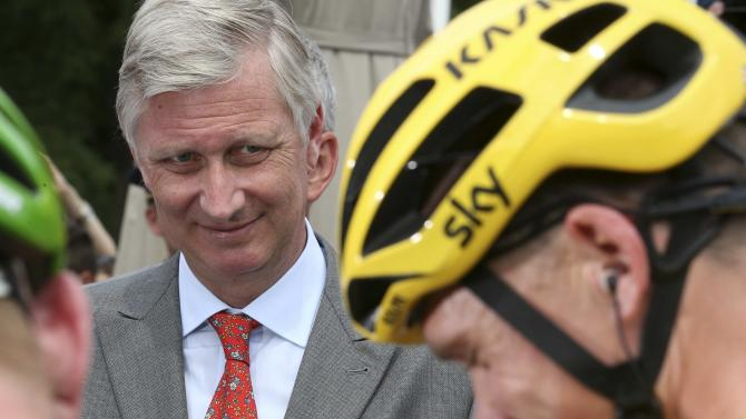 Belgium's King Philippe looks at the race leader and yellow jersey holder, Team Sky rider Chris Froome of Britain, before the 4th stage of the 102nd Tour de France cycling race from Seraing to Cambrai