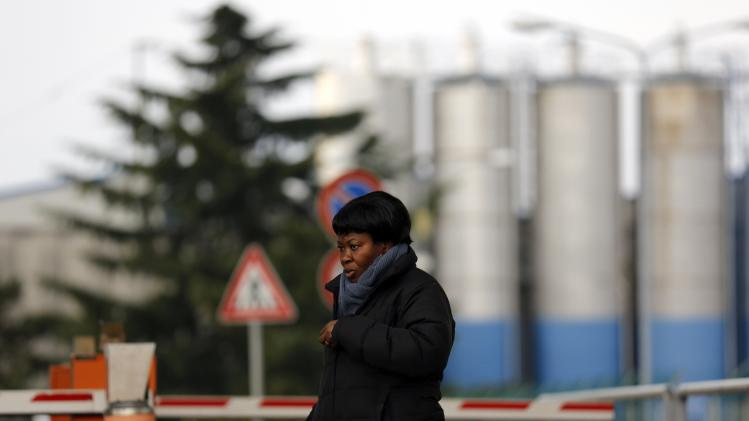 An employee stands outside an Electrolux factory in Porcia, northern Italy
