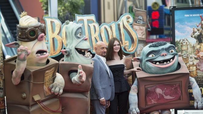 "Cast members Kingsley and Fanning pose with Boxtroll characters at the premiere of ""The Boxtrolls"" at Universal Studios City Walk in Universal City"