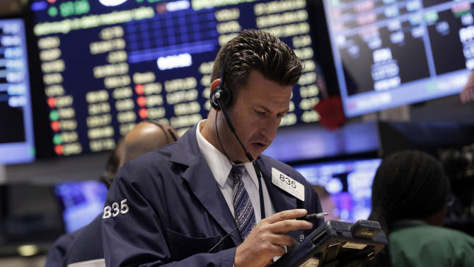 Trader Glenn Kessler works on the floor of the New York Stock Exchange Monday, July 28, 2014. The stock market is opening mixed at the start of a busy week as a batch of merger announcements lift shares in Family Dollar and other companies. (AP Photo/Richard Drew)