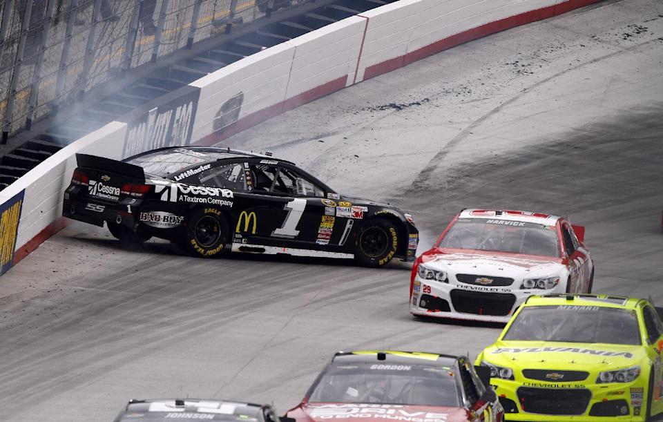 Jamie McMurray (1) spins as driver Kevin Harvick (29) and others get past during the NASCAR Sprint Cup Series Food City 500 auto race on Sunday, March 17, 2013, in Bristol, Tenn. (AP Photo/Wade Payne)