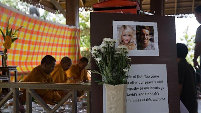 Thai Buddhist monks recite prayers during a religious ceremony held in memory of two murdered British tourists on the southern resort island of Koh Tao on September 18, 2014