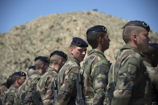 <p>French soldiers, pictured during a transition ceremony with Afghan troops at Surobi base, in April. French President Francois Hollande said on Saturday France will begin its Afghanistan pullout next month and complete it by year-end, after four French troops were killed in a Taliban attack.</p>