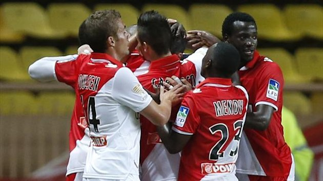 Monaco's defender Lucas Ocampos (C) is congratulated by teammates after scoring during the French League cup football match Monaco (L1) vs Valenciennes (L2), on September 26, 2012 at the Louis II stadium in Monaco