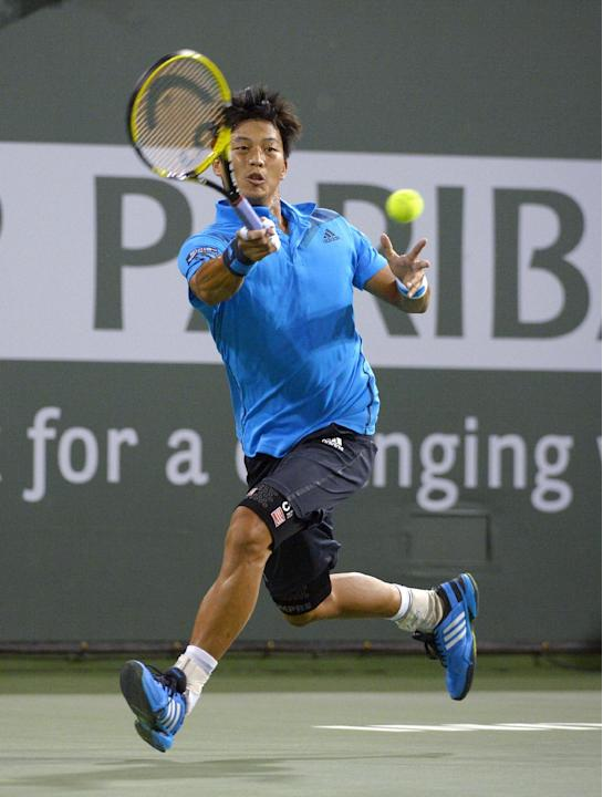 Lu Yen-Hsun, of Taiwan, returns a shot to John Isner, of the United States, at the BNP Paribas Open tennis tournament, Tuesday, March 11, 2014, in Indian Wells, Calif