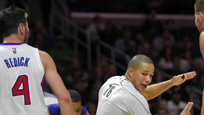 Los Angeles Clippers guard J.J. Redick, left, receives the first of two technical fouls from referee Scott Twardoski during the second half of a preseason NBA basketball game against the Phoenix Suns, Wednesday, Oct. 22, 2014, in Los Angeles. The Clippers won 108-105.(AP Photo/Mark J. Terrill)