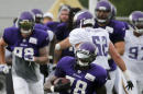 Minnesota Vikings running back Adrian Peterson (28) carries the ball during the first practice in full pads at an NFL football training camp on the campus of Minnesota State University Tuesday, July 28, 2015, in Mankato, Minn. (AP Photo/Charles Rex Arbogast)