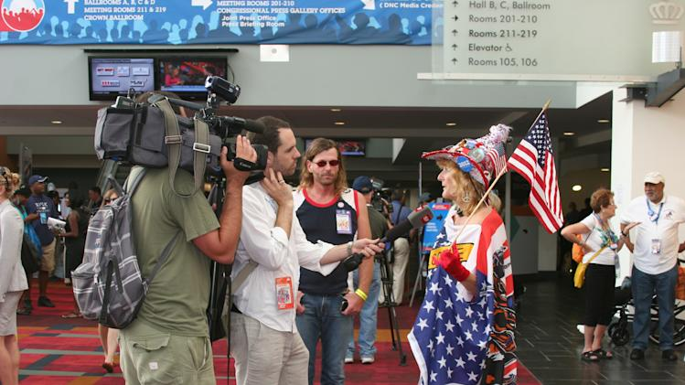 A festively dressed woman is interviewed at the media filing center for the Democratic National Convention on Tuesday Sept. 4, 2012. (Torrey AndersonSchoepe/Yahoo! News)