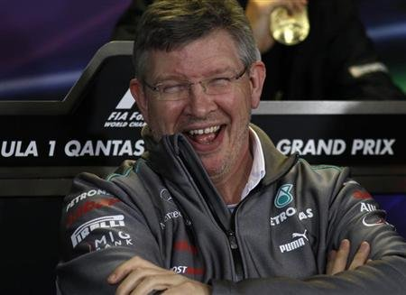 Mercedes Formula One principal Brawn laughs during a new conference following the second practice session of the Australian F1 Grand Prix in Melbourne