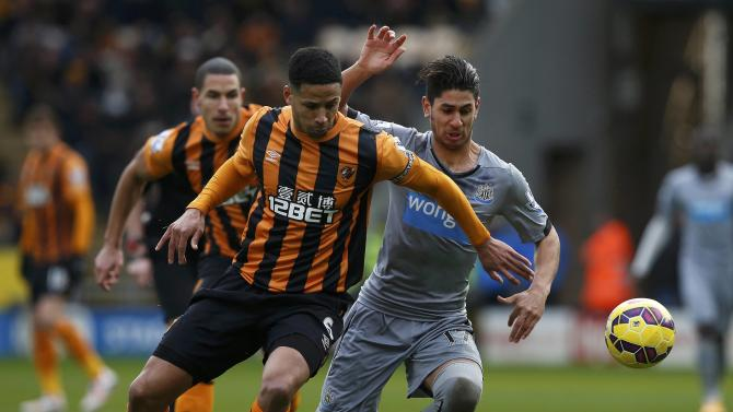 Hull City's Curtis Davies challenges Newcastle United's Ayoze Perez during their English Premier League soccer match at the KC Stadium in Hull