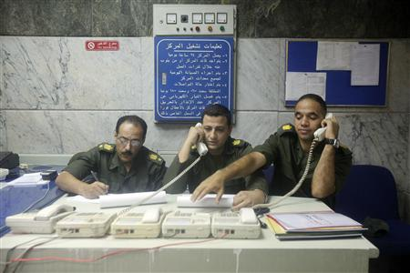 Members of the Egyptian army follow the electoral process at a military operations room in Cairo June 16, 2012.