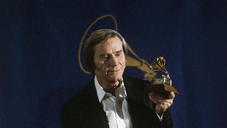 Country singer George Jones poses with the Grammy he won for best male