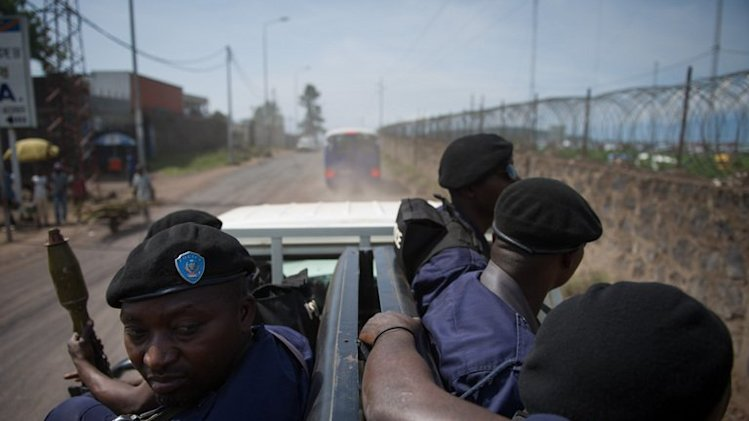 Policemen drive through the street in Goma in the east of the Democratic Republic of the Congo on December 4, 2012