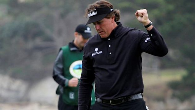 Phil Mickelson reacts after sinking his birdie putt on the 18th green to win the Pebble Beach National Pro-Am golf tournament in Pebble Beach,