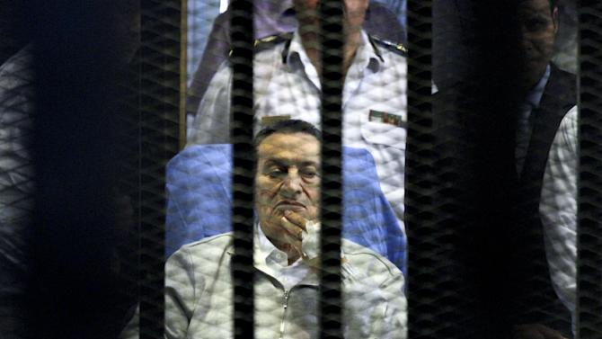 AP10ThingsToSee - Egypt's deposed President Hosni Mubarak attends a hearing session in his retrial on appeal in Cairo, Egypt, Monday, April 15, 2013. Mubarak will remain in custody on new corruption charges despite a court order to release him on bail pending his retrial on charges related to killing of protesters in the 2011 uprising against him, Egypt's state news agency said Monday. (AP Photo/Ahmed Gomaa, File)