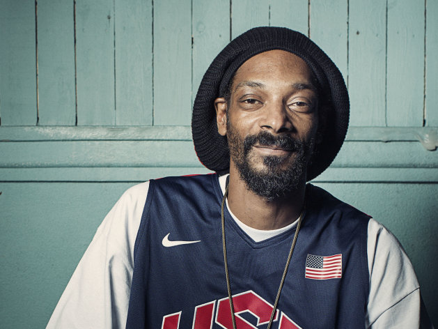This Monday, July 30, 2012 photo shows Snoop Dogg, who now goes by Snoop Lion, posing for a portrait at Miss Lily&#39;s in New York. The rapper says he would like to be a judge on American Idol. After hearing of the millions Idol judges earned on the show, Snoop told The Associated Press this week: Oh hell yeah I&#39;ll do &#39;American Idol.&#39; The 40-year-old announced this week that he has changed his name to Snoop Lion after rediscovering himself after a life-changing trip to Jamaica. (Photo by Victoria Will/Invision/AP)