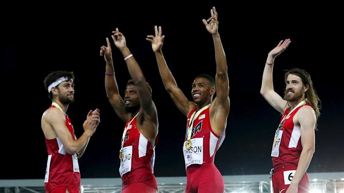 The U.S. Distance Medley Relay team celebrate on the medal podium after setting a new world record at the IAAF World Relays Championships in Nassau