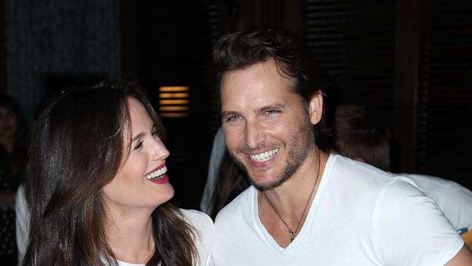 """Actress Elizabeth Reaser, left, and actor Peter Facinelli pose together at Summit Entertainment's """"The Twilight Saga: Breaking Dawn - Part 2"""" VIP Comic-Con celebration, Wednesday, July 11, 2012, in San Diego. (Photo by Matt Sayles/Invision/AP)"""