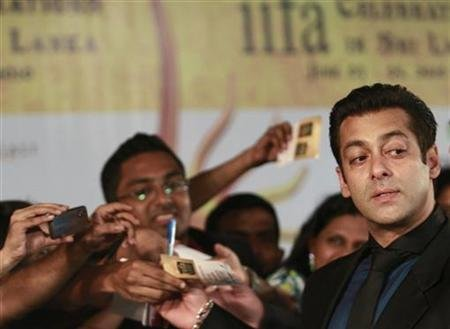 Bollywood actor Salman Khan reacts on the green carpet for the IIFA awards in Colombo