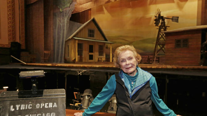 """In this April 26, 2013 photo, choreographer Gemze de Lappe  stands by the set of Rodgers and Hammerstein's """"Oklahoma!"""" at the Lyric Opera of Chicago. De Lappe first danced in """"Oklahoma!"""" in 1943 as a member of the Broadway hit's first national touring company and now 70 years later at age 91 she's choreographing a production of the musical at the Lyric. (AP Photo/M. Spencer Green)"""