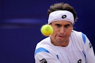 Spanish David Ferrer returns the ball to Canadian Milos Raonic during their semi-final match at the Barcelona Open tennis tournament Conde de Godo. Ferrer overcame 15 aces from Raonic to book his fourth final at the tournament with a 7-6 (7/2), 7-6 (7/5) win against the Canadian