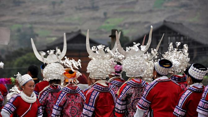 Ethnic Miao people wearing traditional costumes parade during Chinese Lunar New Year celebrations, in Taijiang county