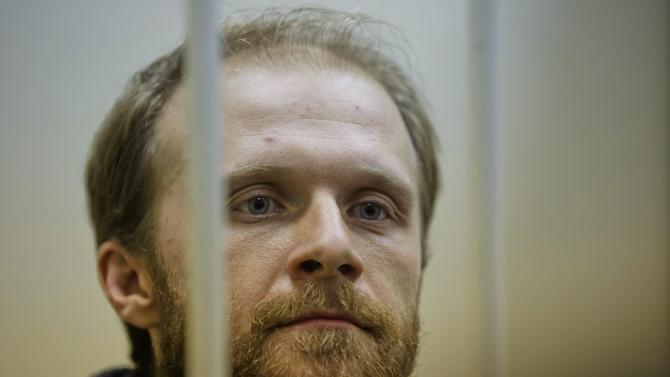 Russian court frees 2 Greenpeace members on bail
