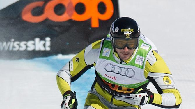 Canada's Nick Zoricic, top, speeds down during the skicross World Cup finals, Saturday March 10, 2012 in Grindelwald Switzerland. Zoricic died from head injuries after crashing heavily in the skicross event on Saturday, the International Ski Federation said.  (AP Photo/Keystone, Samuel Truempy)
