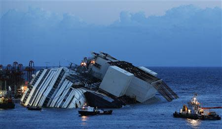 The capsized cruise liner Costa Concordia lies on its side next to Giglio Island