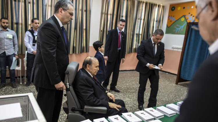 Algeria's President Abdelaziz Bouteflika arrives to cast his ballot during the presidential election in Algiers