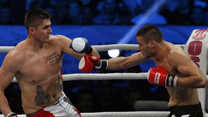 Former NBA player Darko Milicic, left, fights against Radovan Radojcin during their kickboxing match at the Soul Night of Champions, in Novi Sad, Serbia, Thursday, Dec. 18, 2014. Milicic is switching from basketball to kickboxing. (AP Photo/Darko Vojinovic)