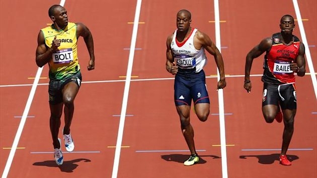 Usain Bolt (L) of Jamaica checks competitors James Dasaolu (C) of Britain and Daniel Bailey of Antigua and Barbuda