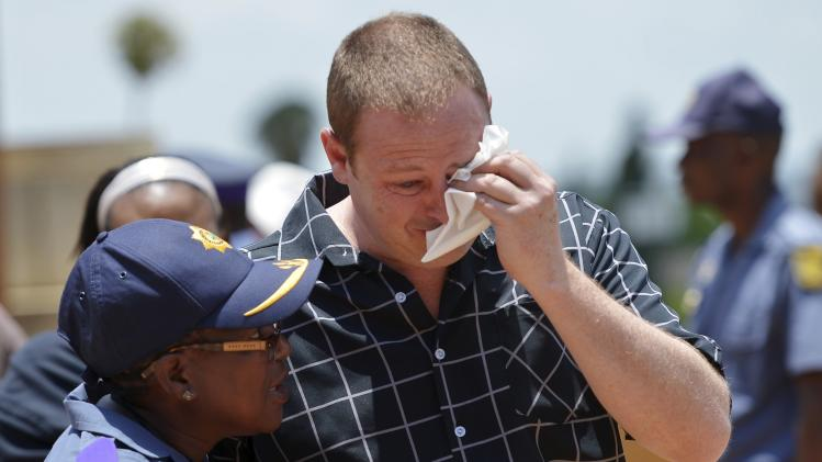 A man reacts after paying his respects to former South African President Mandela on the last day of Mandela's lying in state at the Union Buildings in Pretoria