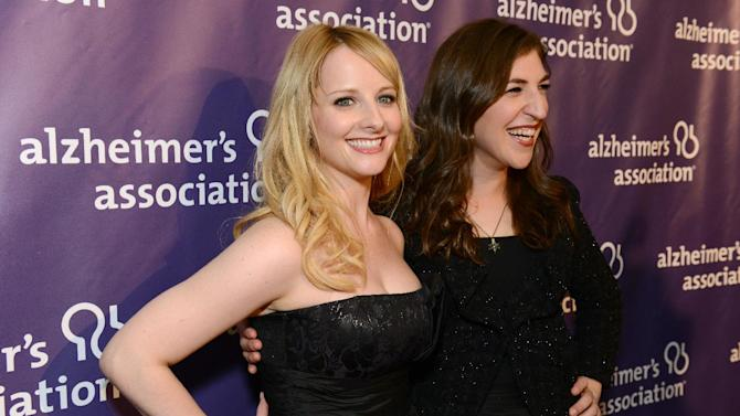 Actresses Melissa Rauch, left, and Mayim Bialik arrive at the 21st Annual 'A Night at Sardi's' to benefit the Alzheimer's Association at the Beverly Hilton Hotel on Wednesday, March 20, 2013 in Beverly Hills, Calif. (Photo by Jordan Strauss/Invision for Alzheimer's Association/AP Images)