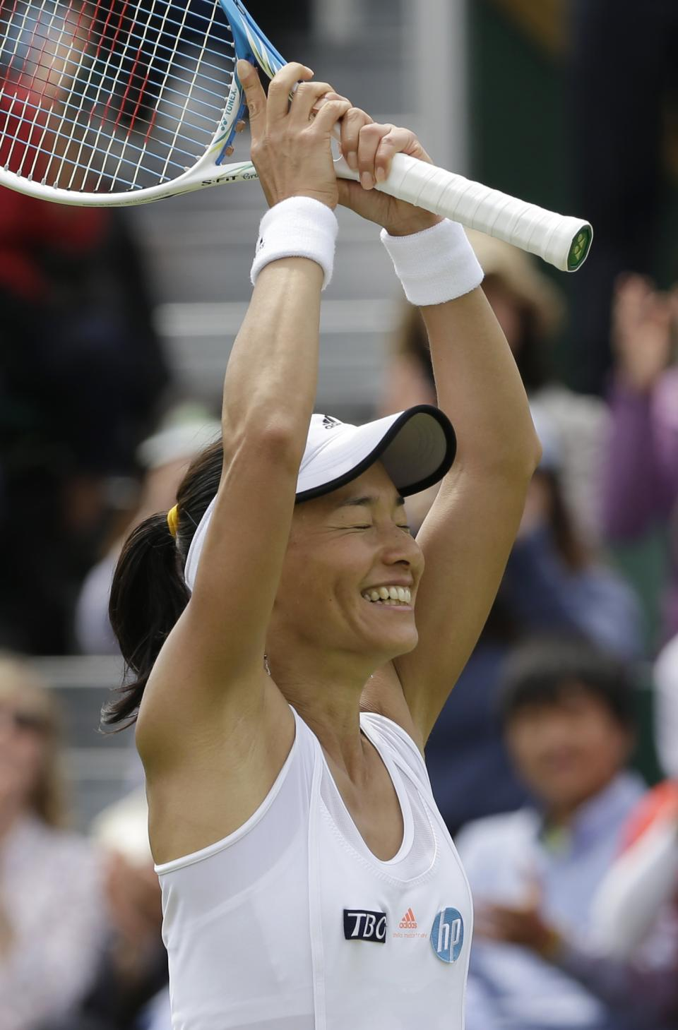 Kimiko Date-Krumm of Japan reacts after defeating Alexandra Cadantu of Romania during their Women's second round singles match at the All England Lawn Tennis Championships in Wimbledon, London, Thursday, June 27, 2013. (AP Photo/Anja Niedringhaus)