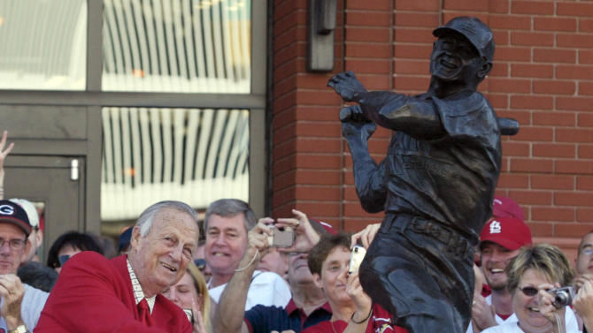 """FILE - In this Oct. 1, 2006, file photo, St. Louis Cardinals great Stan """"The Man"""" Musial strikes his signature pose after unveiling his statue at the re-dedication ceremony for the statues, at the new Busch Stadium, of Cardinals Hall-of- Famers and notables before a baseball game against the Milwaulkee Brewers in St. Louis. Musial, one of baseball's greatest hitters and a Hall of Famer with the St. Louis Cardinals for more than two decades, died Saturday, Jan 19, 2012, the Cardinals announced. He was 92. (AP Photo/Tom Gannam, File)"""