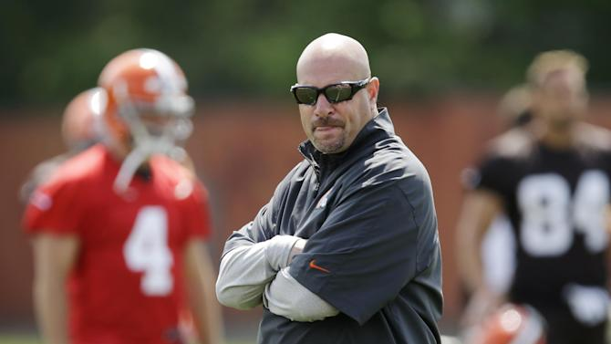 Cleveland Browns head coach Mike Pettine watches organized team activities at the NFL football team's facility in Berea, Ohio Tuesday, June 3, 2014