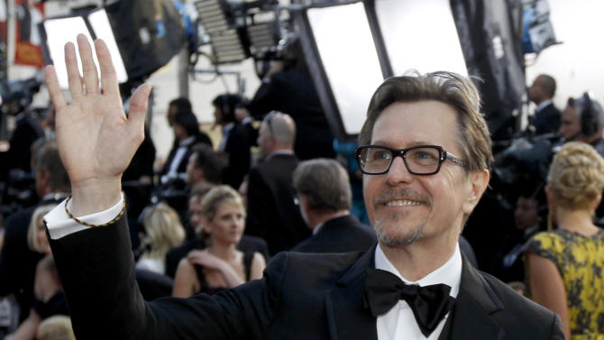 CORRECTS ID TO GARY OLDMAN INSTEAD OF MICHEL HAZANAVICIUS - Gary Oldman arrives before the 84th Academy Awards on Sunday, Feb. 26, 2012, in the Hollywood section of Los Angeles. (AP Photo/Chris Carlson)