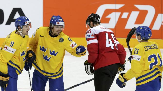 Sweden's Lander celebrates with his teammates Forsberg and Eriksson after scoring a goal past Austria's Florian Iberer during their Ice Hockey World Championship game at the O2 arena in Prague