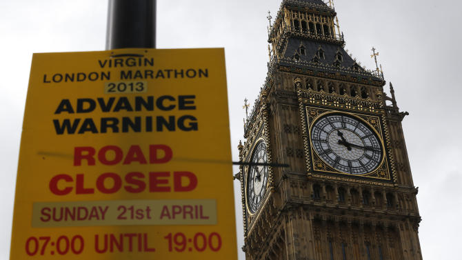 Back dropped by the landmark commonly known as, Big Ben, a warning sign for road closures at the forthcoming London Marathon is displayed along the marathon route in London, Tuesday, April 16, 2013. British police are reviewing security plans for Sunday's London Marathon, the next major international marathon, because of the bombs that killed three people at the marathon in Boston Monday. (AP Photo/Sang Tan)