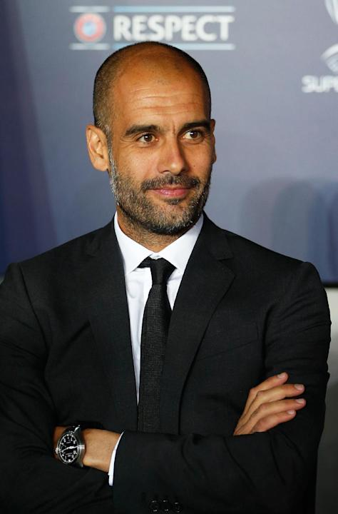 In this Aug. 30, 2013 file photo Bayern head coach Pep Guardiola of Spain waits for the start of the soccer Super Cup final between Champions League winner Bayern Munich and Europa League winner Chels