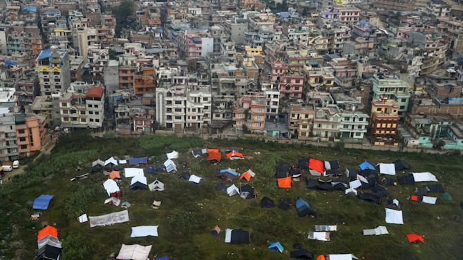 Nepali sleep in provisional tents and under plastic sheets after Saturday's earthquake, near the airport of Kathmandu