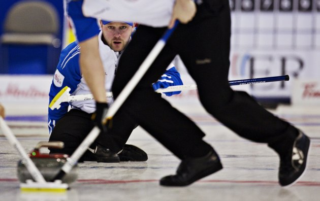 British Columbia skip Bilesky watches the line of his shot during the Canadian Men's Curling Championships in Edmonton