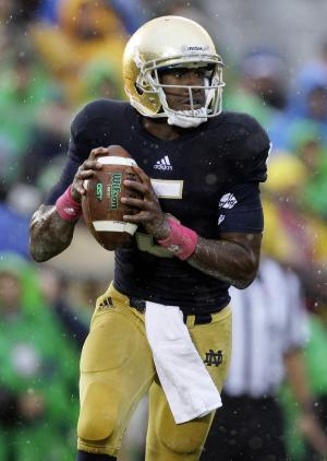Notre Dame quarterback Everett Golson rolls out to pass during the first half of an NCAA college football game against Stanford in South Bend, Ind., Saturday, Oct. 13, 2012. (AP Photo/Nam Y. Huh)
