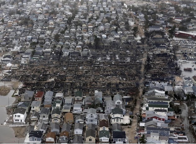 This aerial photo shows burned-out homes in the Breezy Point section of the Queens borough New York after a fire on Tuesday, Oct. 30, 2012. The tiny beachfront neighborhood told to evacuate before San