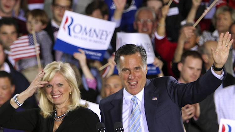 Republican presidential candidate, former Massachusetts governor Mitt Romney and his wife Ann wave to supporters Tuesday, April 24, 2012, in Manchester, N.H. (AP Photo/Jim Cole)